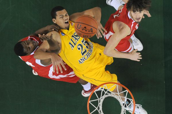 Phillip Ward of Nicholls State, left, pulls UAA's Malcolm Campbell off the ball as Anatoly Bose of Nicholls State watches in the 2009 Great Alaska Shootout at the Sullivan Arena on Thursday, November 26, 2009. (Bob Hallinen / ADN archive 2009)