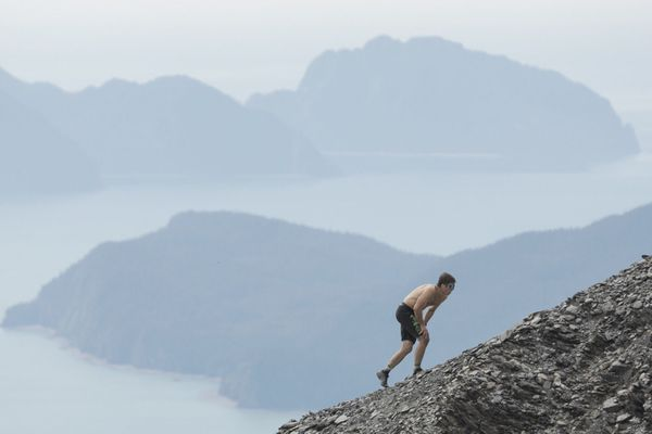 David Norris climbs up the shale field during the men's Mount Marathon race in Seward on Wednesday, July 4, 2018. (Loren Holmes / ADN)