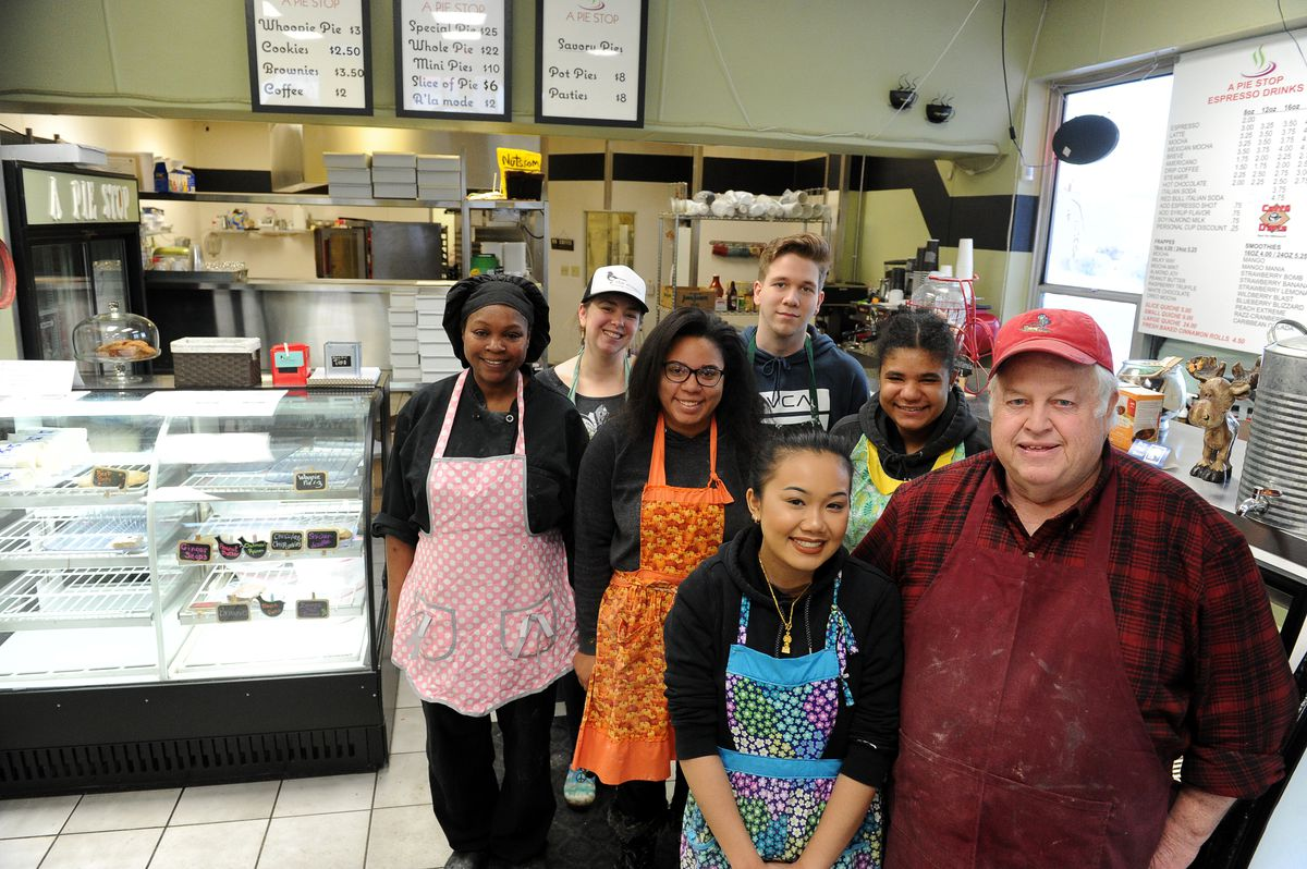 Alisa Louangaphay, her grandfather Steve Satterlee and the crew at the Pie Stop pose in the shop in west Anchorage on Wednesday, Dec. 27, 2017. Satterlee bought the shop for his 18-year-old granddaughter. The staff at A Pie Stop is mostly made up of Louangaphay's classmates from the King Career Center culinary program. (Bob Hallinen / ADN)