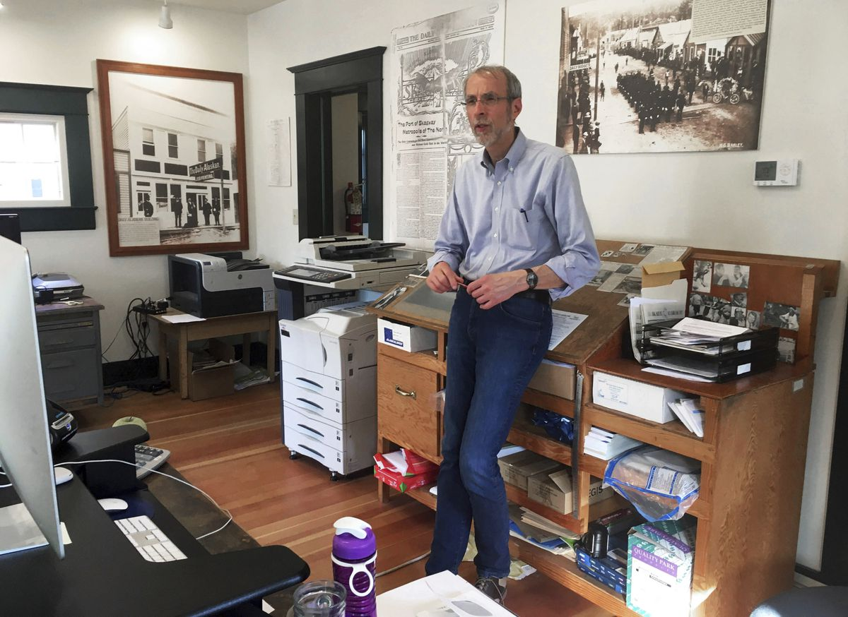 This May 29, 2019 photo shows Larry Persily, the publisher of The Skagway News, in the newspaper office in Skagway. (Molly McCammon via AP)