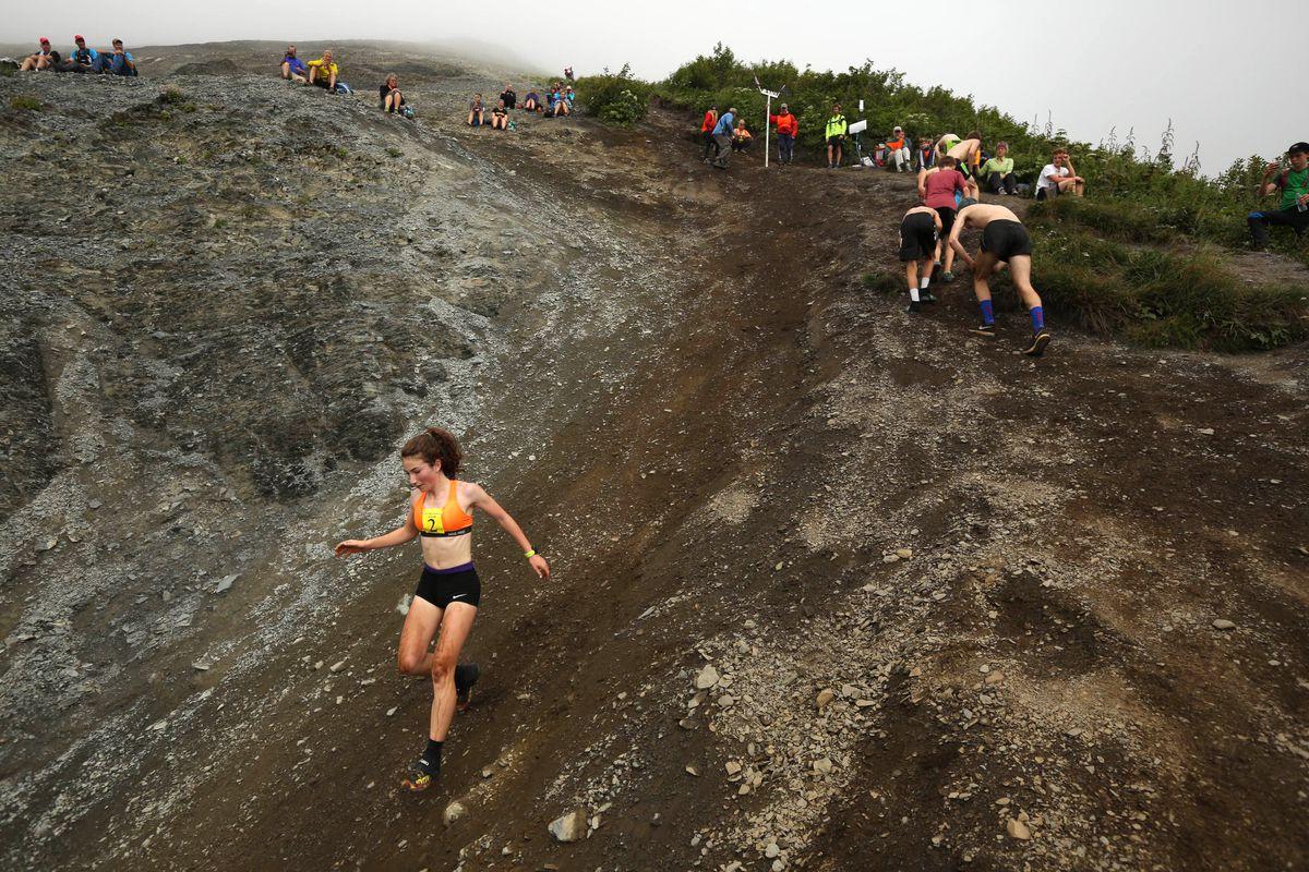 Molly Gellert scrambles down Mount Marathonin the junior's race. (Loren Holmes / Alaska Dispatch News)
