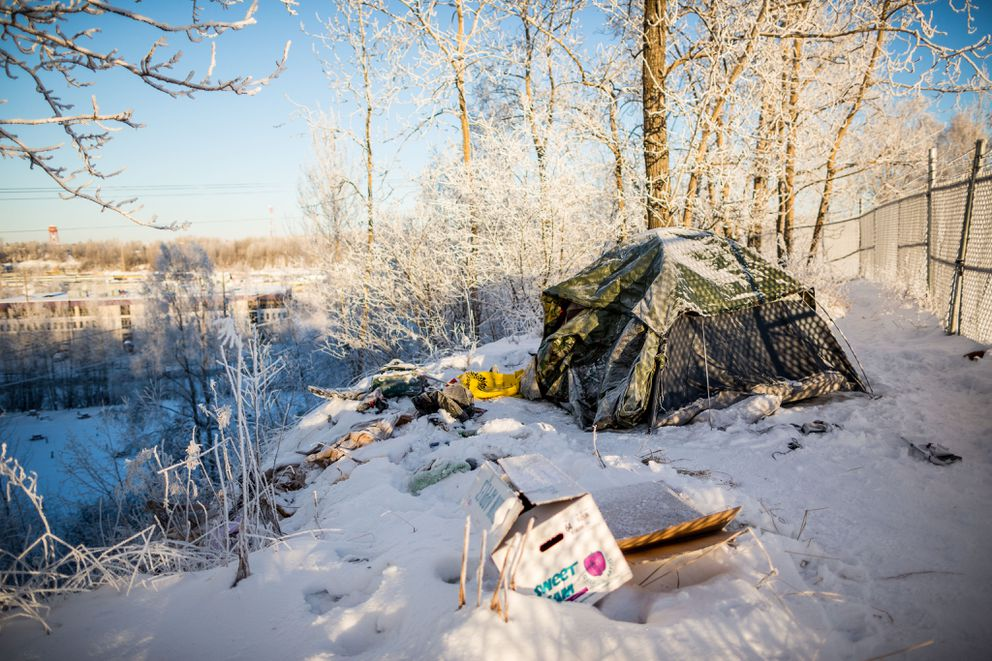 A homeless camp above Anchorage's Ship Creek area in winter, photographed on Nov. 29, 2013. (Loren Holmes / ADN archive)