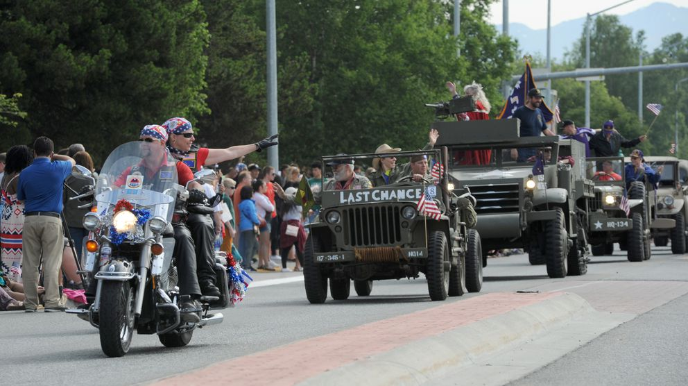 Motorcycles and vintage military vehicles roll downNinth Avenue. (Anne Raup / ADN)
