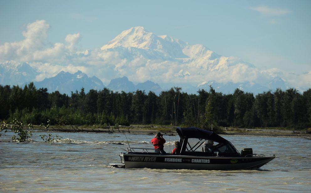 Anglers on a Fishbone Charters boat make photographs of Denali on the Chulitna River at Talkeetna on July 27, 2012. (Bob Hallinen / ADN)