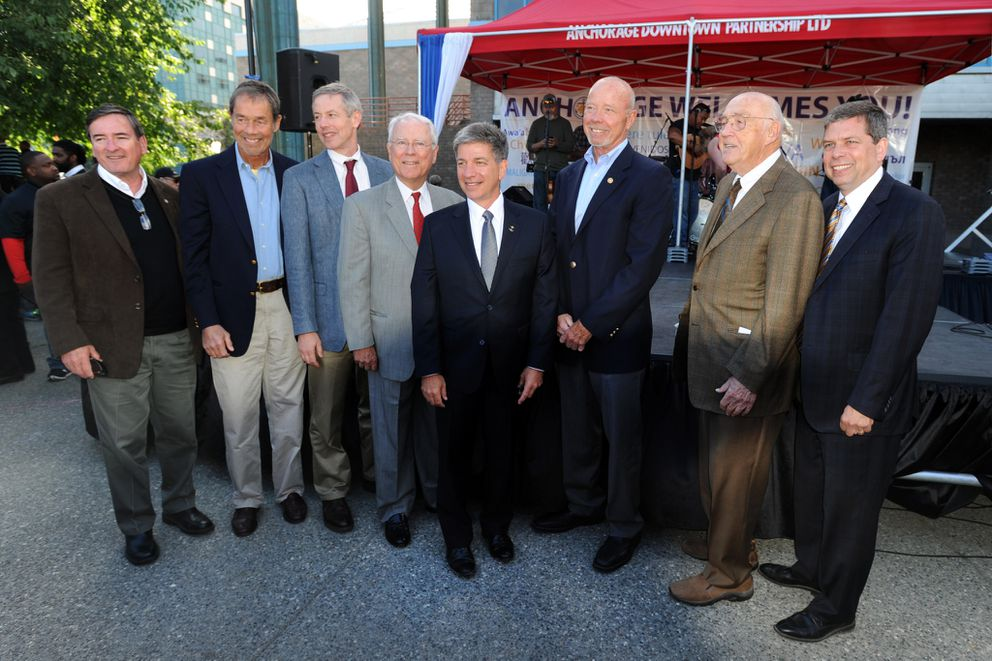Anchorage mayors from left Dan Sullivan, Tony Knowles, Matt Claman, George Wuerch, Ethan Berkowitz, Rick Mystrom, Jack Roderick and Mark Begich pose together following an inaugural ceremony for Berkowitz held Wednesday afternoon, July 1, 2015, in Town Square Park. (Erik Hill / ADN archive)
