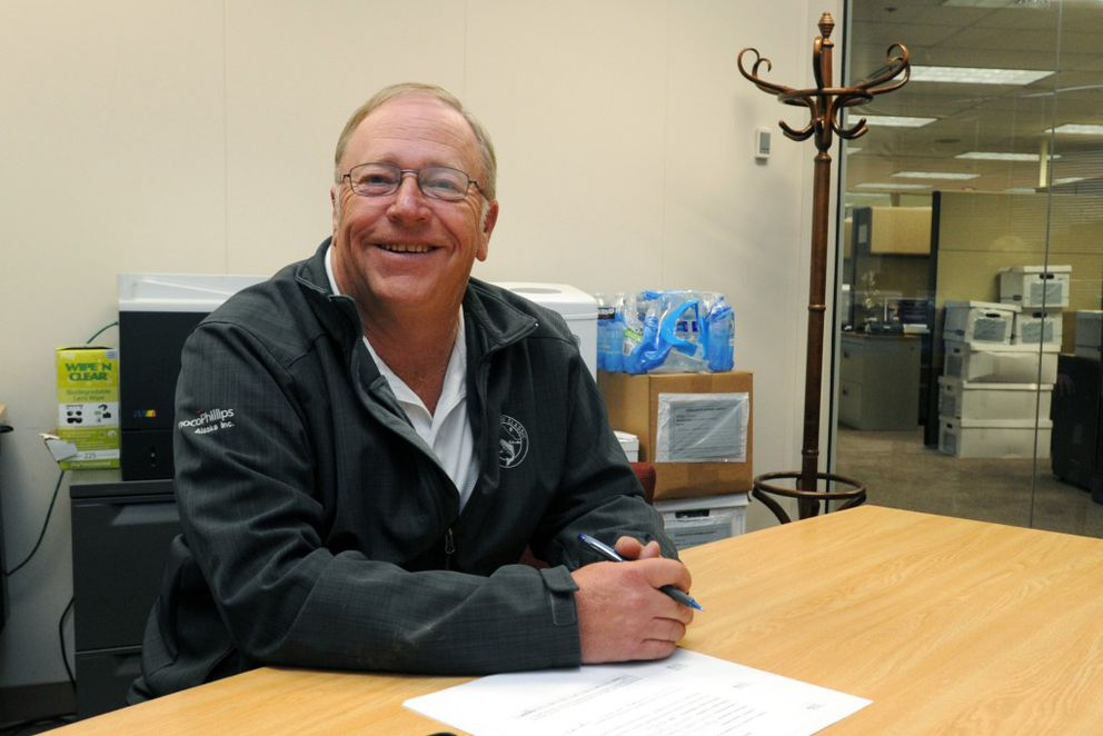 Rep. Mike Chenault settles in to new office space on Monday. (Erik Hill / Alaska Dispatch News)