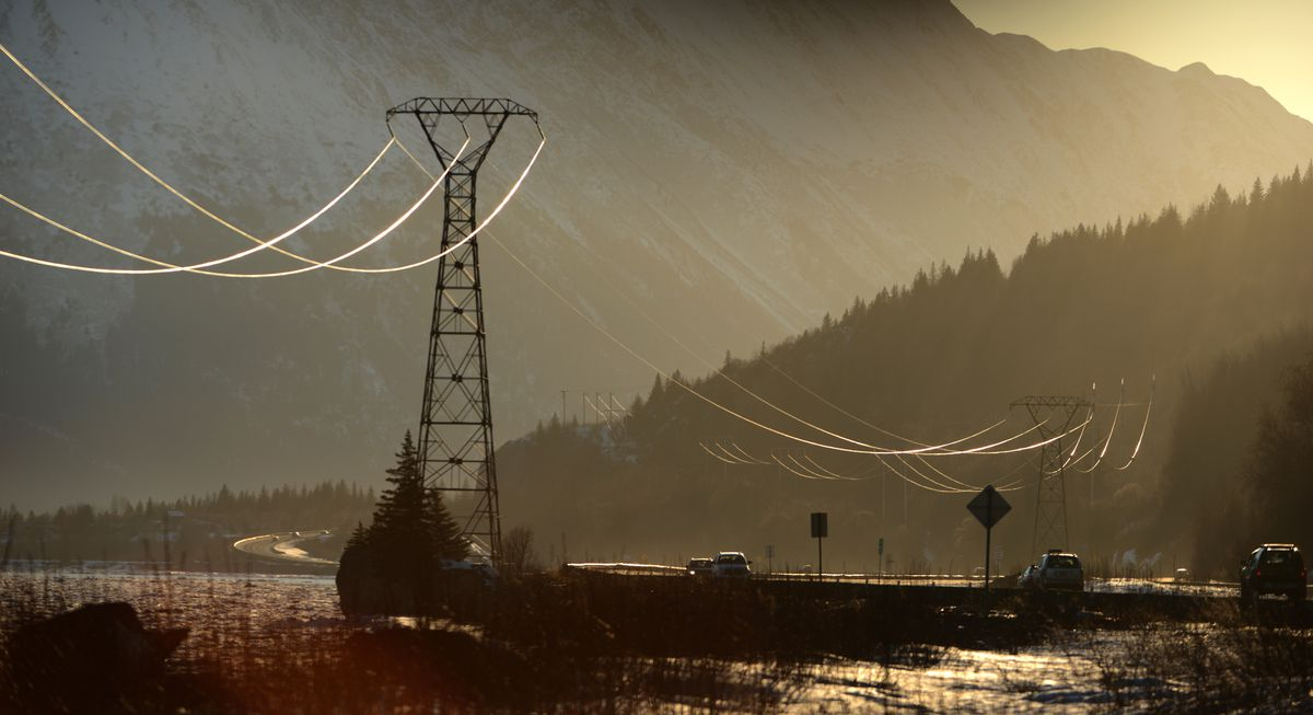 Power lines are highlighted by the setting sun along Turnagain Arm and the Seward Highway south of Anchorage, Alaska on Sunday, March 26, 2017. (Bob Hallinen/ADN)