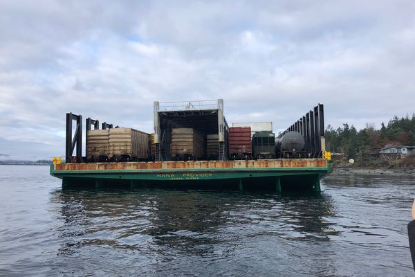 The Nana Provider hit ground near Quadra Island Saturday night in British Columbia. Crews were working Monday to refloat the Alaskan barge. (Photo provided by the Canadian Coast Guard.)