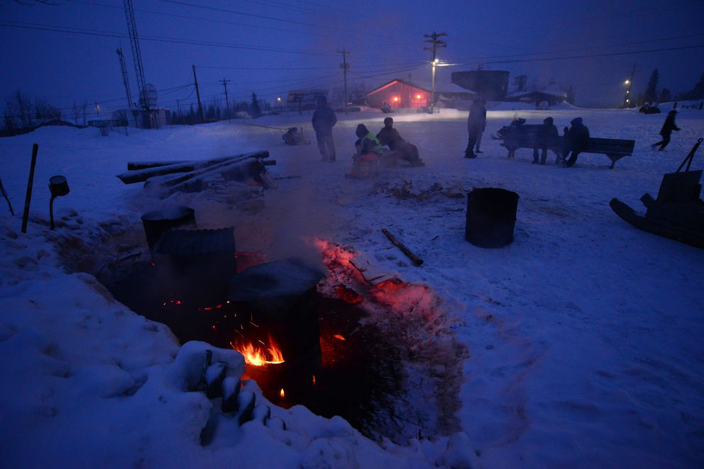 Volunteers at the Ambler checkpoint keep dog pots boiling through the night, so Kobuk 440 mushers can water their dogs when they arrive from the trail. (Photo by Berett Wilber)
