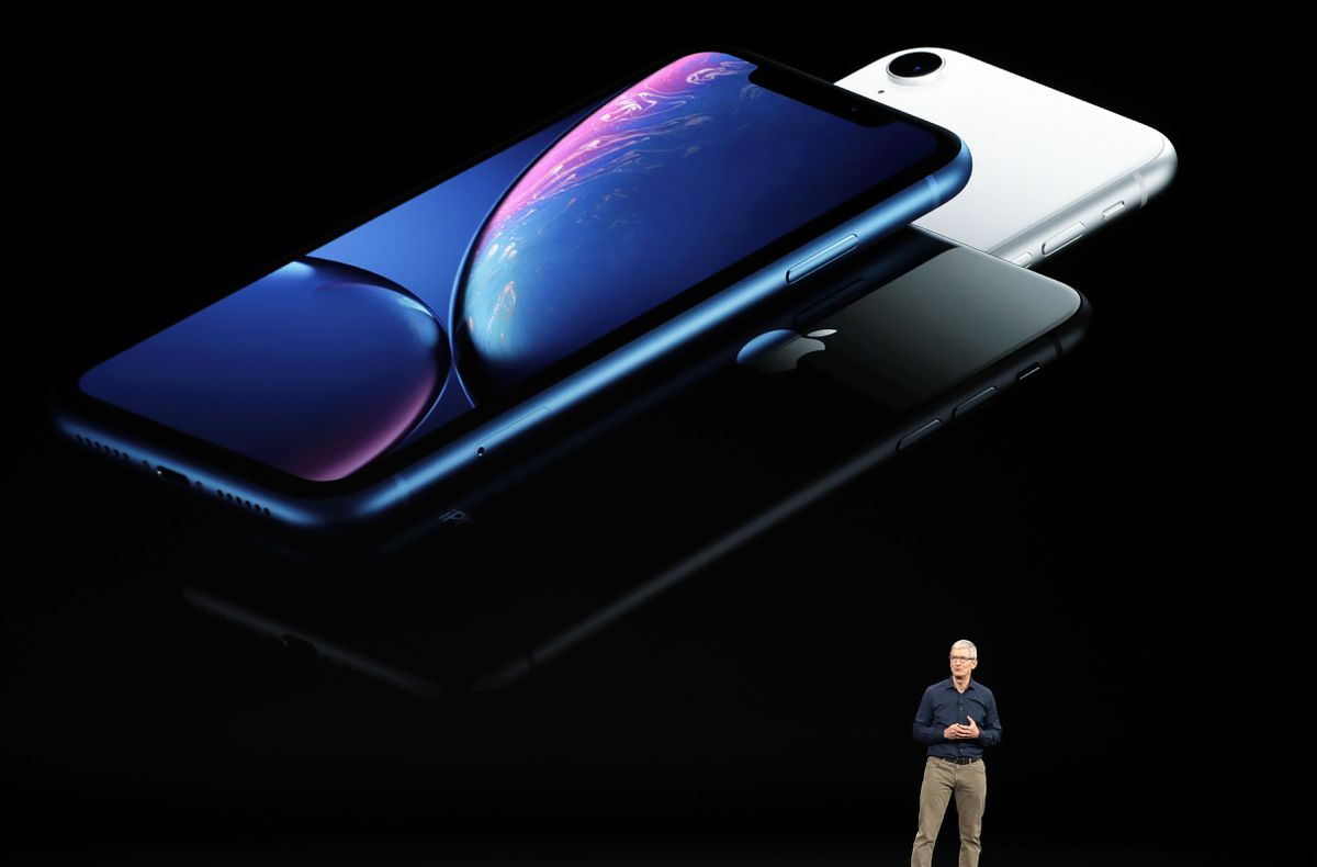 Apple CEO Tim Cook discusses the new iPhones at the Steve Jobs Theater during an event to announce new products Wednesday, Sept. 12, 2018, in Cupertino, Calif. (AP Photo/Marcio Jose Sanchez)