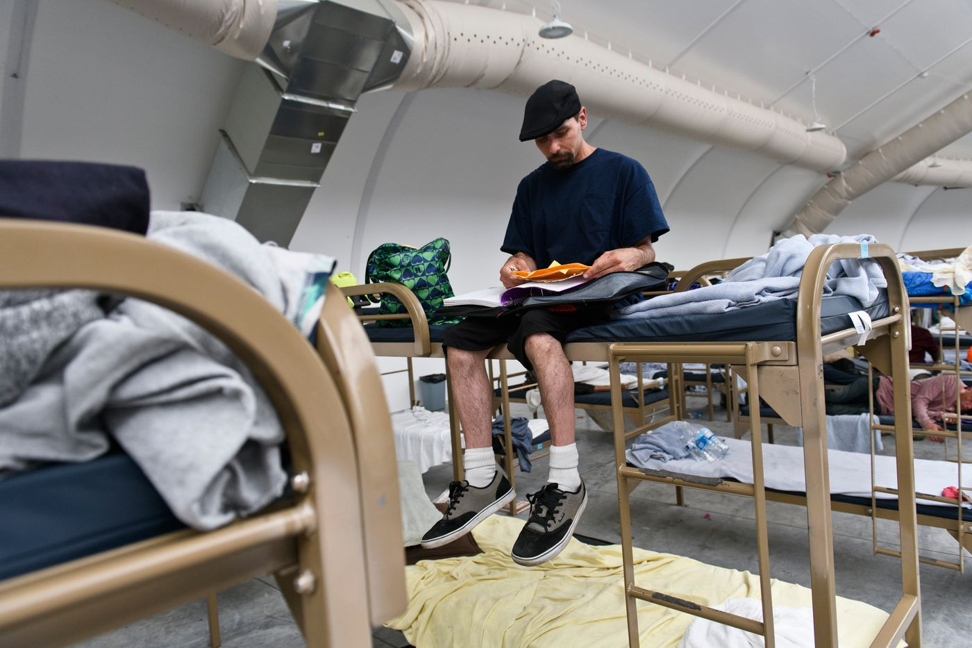 Jesse Kramer writes phone numbers and other information in his notebook at the Nevada CARES Campus. 'I'm just trying to get my life together. I know there's resources, ' he said of the facility. (Marc Lester / ADN)