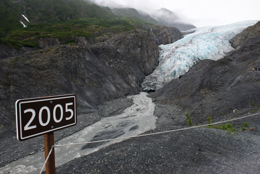 A sign, seen here on July 17, gives visitors a sense of how far Exit Glacier has retreated in the last dozen years.  (Marc Lester / Alaska Dispatch News)