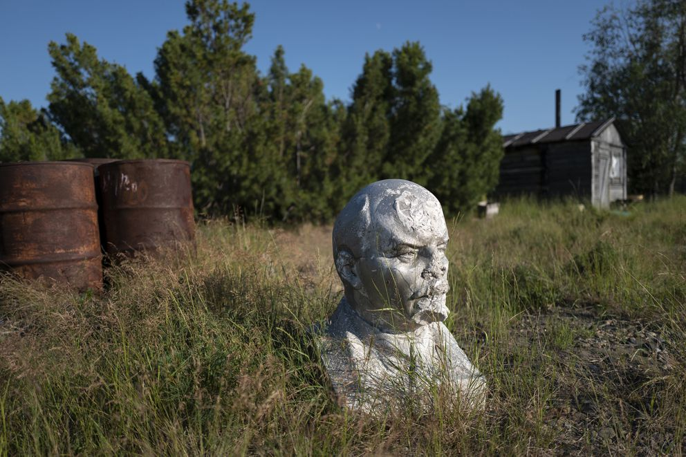 A decaying bust of Vladimir Lenin sits on the banks of the Kolyma River in Siberia. (Washington Post by Michael Robinson Chavez)