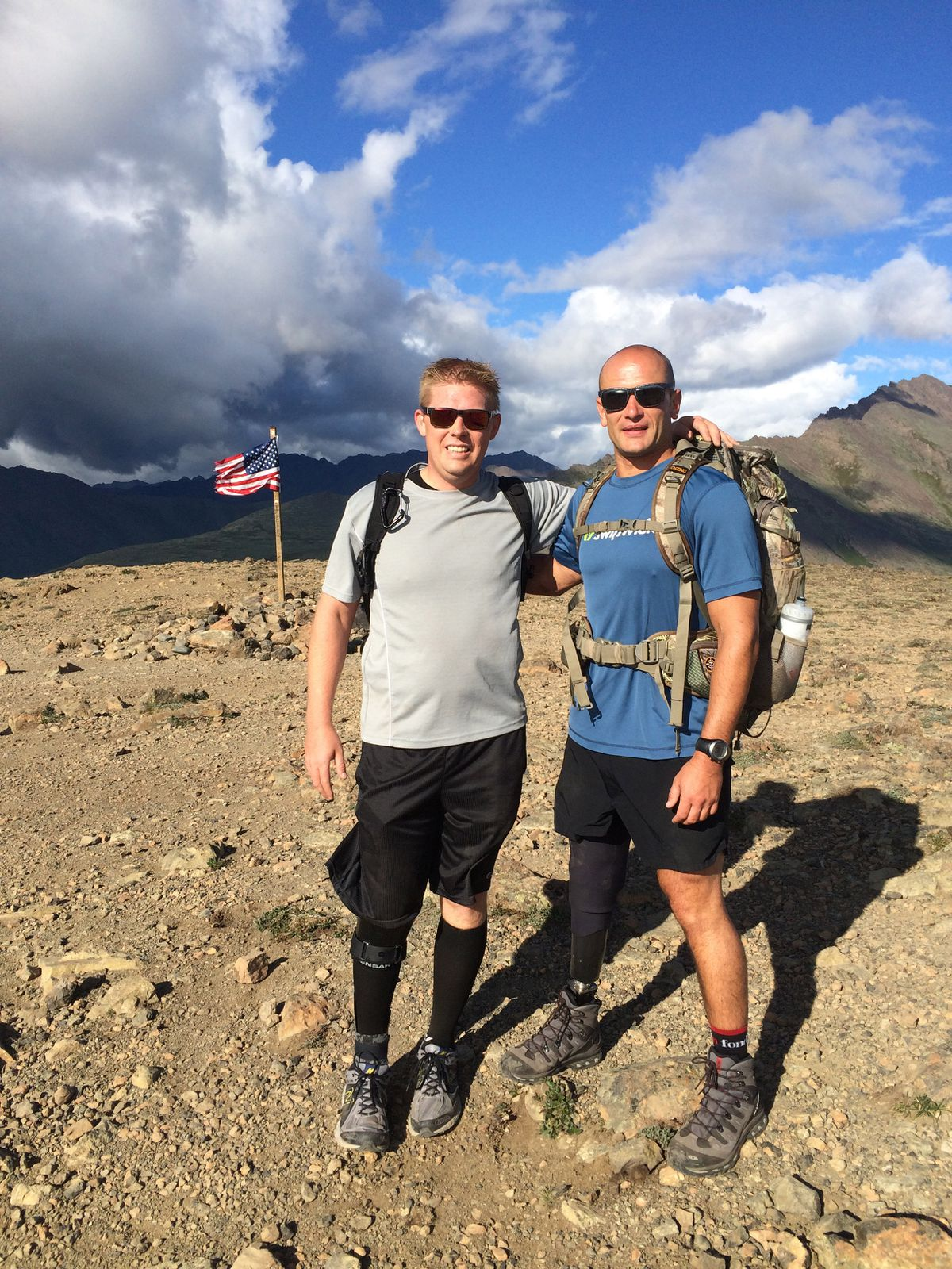"Josh Revak, left, stands with Joe Kapacziewski on top of Flattop last summer, about a month after Revak was fitted with a prostethic device for his right foot. Kapacziewski is an Army Ranger who is still active duty despite losing his leg in combat. ""He has been a huge inspiration to me,"" Revak said. (Photo courtesy of Josh Revak)"