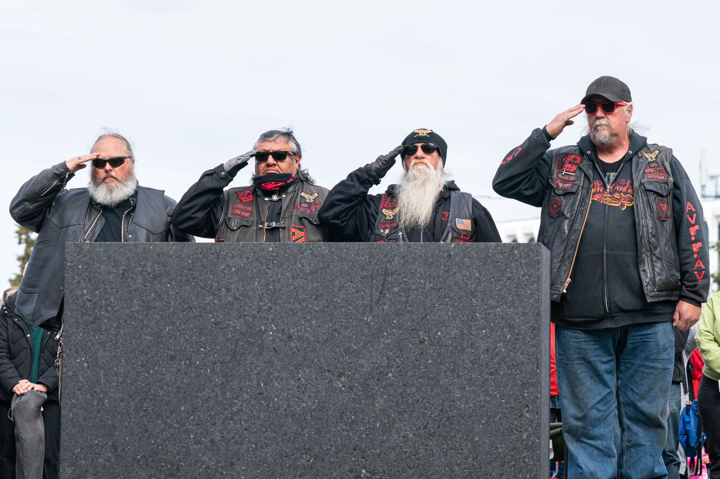 Alaska Vets Motorcycle Club salute the Fallen Warrior statue at the Anchorage Veterans Memorial on Delaney Park Strip on Monday, May 25, 2020 during a Memorial Day observance. (Loren Holmes / ADN)