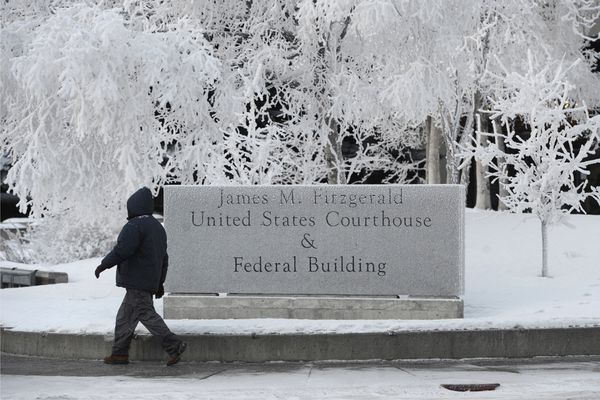 A pedestrian walks past the U.S. Courthouse and Federal Building in downtown Anchorage that remains open but is eerily quiet during the federal shutdown on Monday, Jan. 7, 2019. (Bill Roth / ADN)