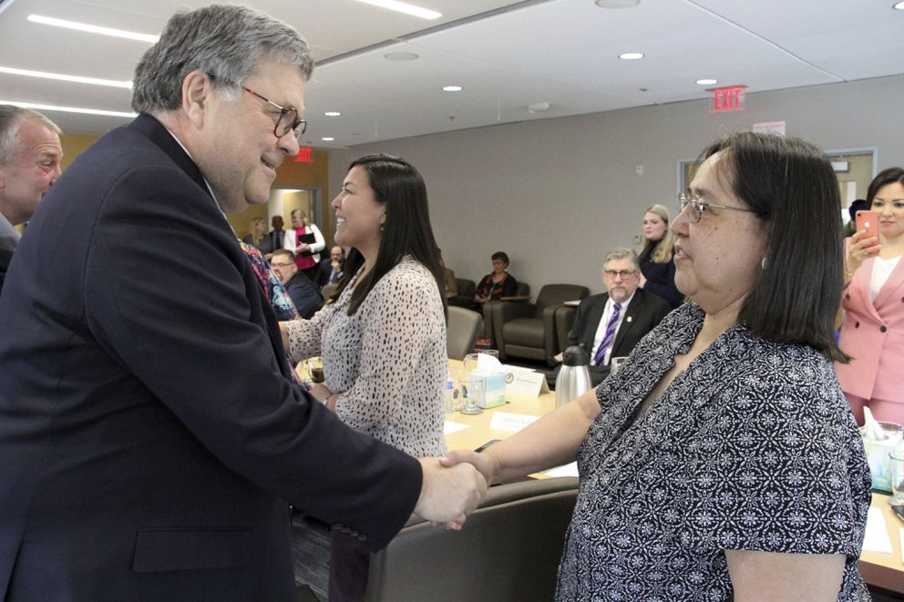 U.S. Attorney General William Barr, left, greets Vivian Korthuis with the Association of Village Council Presidents. (AP Photo/Mark Thiessen)