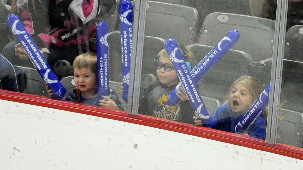Pint-size fans make some noise for the Swawolves. (Bob Hallinen / ADN)