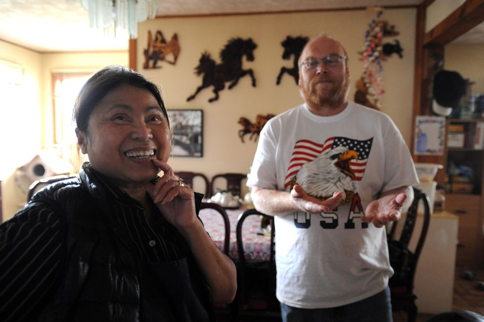 Tuoi Yungbauer and her husband, Albert Yungbauer, at their home in Mountain View. Theymet while working together at KFC. (Bill Roth / Alaska Dispatch News)