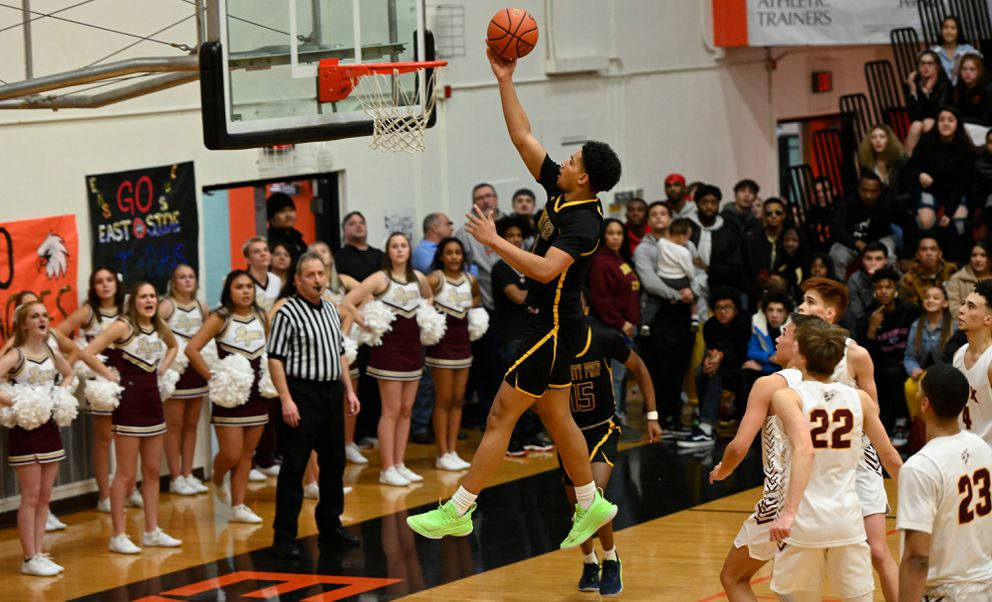Daishen Nix lays the ball up in the championship game of the Alaska Airlines Classic tournament in Anchorage on January 25, 2020. Nix and his Trinity International team beat Dimond to win the tournament title. (Marc Lester / Anchorage Daily News)