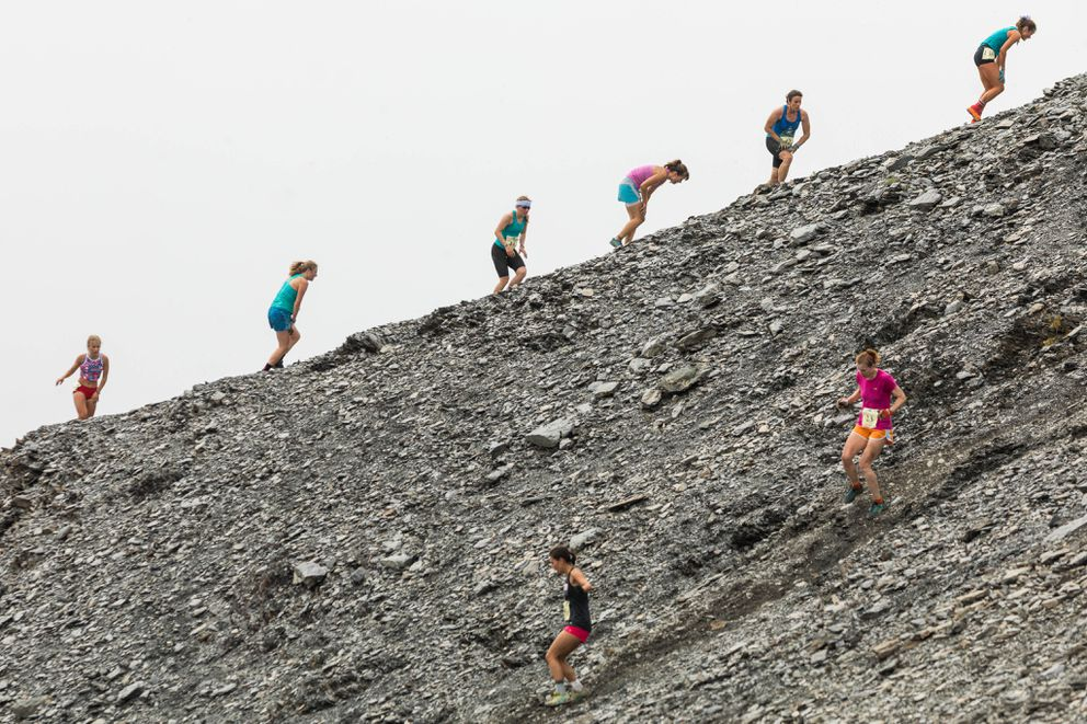 As some women continue the arduous climb up Mount Marathon, others careen down the peak during last year's race.  (Loren Holmes / ADN archive)
