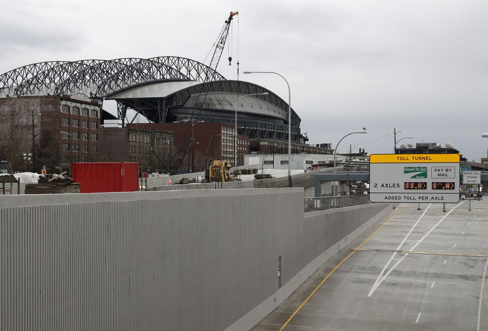 A toll sign on a ramp leading to the tunnel that will replace the Alaskan Way Viaduct is shown near T-Mobile Park, Wednesday, Jan. 9, 2019, in Seattle. The double-decker viaduct, a major thoroughfare for commuters along downtown Seattle's waterfront, is set to shut down for good, Friday, Jan. 11, 2019, before it is replaced by the four-lane tunnel, ushering in what officials say will be one of the most painful traffic periods in the history of the city. (AP Photo/Ted S. Warren)