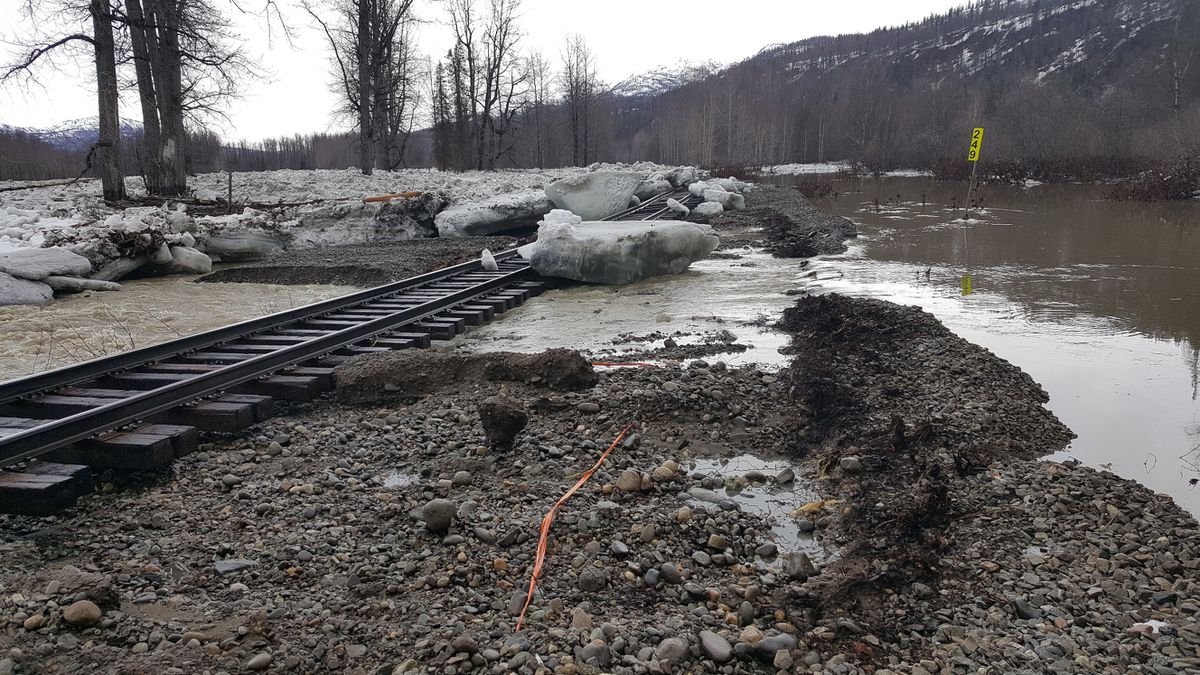 "A 7-foot ""wall of ice"" from a Susitna River ice jam slammed into Alaska Railroad tracks north of Talkeetna after flooding on Saturday, May 12, 2018, pushing the rails 25 feet off course. (Photo courtesy Alaska Railroad)"