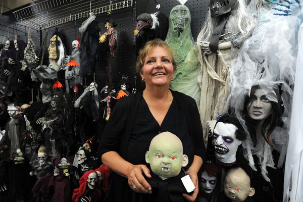 Kim Hunt pauses in a scary section of her Partycraft store on Friday, July 21, 2017, in Midtown. Online shopping and a local economic downturn have forced her to lay off employees and reduce inventory. (Erik Hill / Alaska Dispatch News)