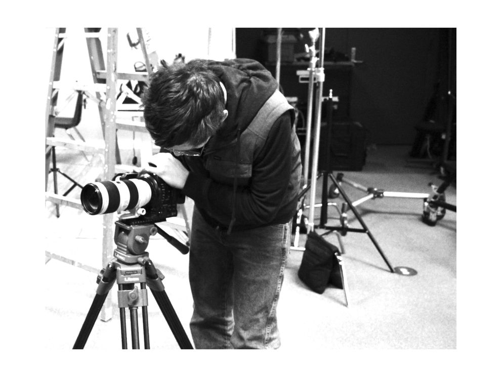 Isaac in front of his camera. (Photo by Fischer Knapp)