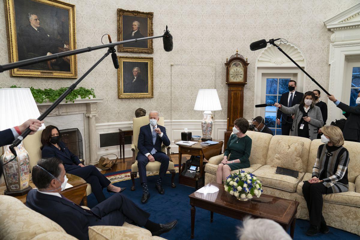 President Joe Biden meets Republican lawmakers to discuss a coronavirus relief package, in the Oval Office of the White House, Monday, Feb. 1, 2021, in Washington. From left, Sen. Mitt Romney, R-Utah, Vice President Kamala Harris, Biden, Sen. Susan Collins, R-Maine, and Sen. Lisa Murkowski, R-Alaska. (AP Photo/Evan Vucci)
