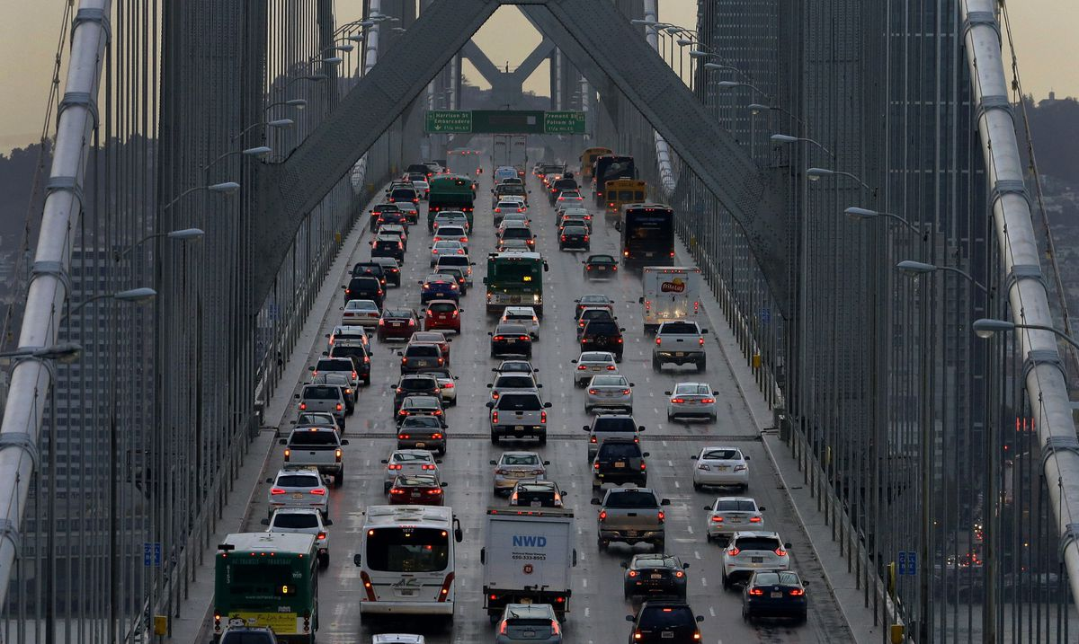 In this Dec. 10, 2015, photo, vehicles make their way westbound on Interstate 80 across the San Francisco-Oakland Bay Bridge as seen from Treasure Island in San Francisco. Four major automakers have reached a deal with California to increase gas mileage and greenhouse gas emissions standards, bypassing the Trump administration's plan to freeze standards at 2021 levels. (AP Photo/Ben Margot, File)