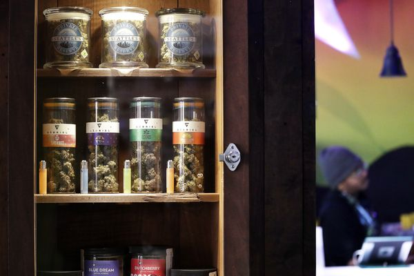 In this photo taken Thursday, March 28, 2019, marijuana products line a locked cabinet at a marijuana shop in Seattle. When Washington and Colorado launched their pioneering marijuana industries in the face of U.S. government prohibition, they imposed strict rules in hopes of keeping the U.S. Justice Department at bay. Five years later, federal authorities have stayed away, but the industry says it has been stifled by over-regulation. Lawmakers in both states have heard the complaints and are moving to ease the rules. (AP Photo/Elaine Thompson)
