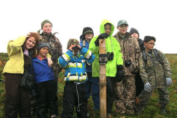 In an undated photo, Cold Bay teacher-principal Kerry Burkhardt and Cold Bay students take a field trip with Izembek National Wildlife Refuge staff. Facing low enrollment numbers, the school is set to close.