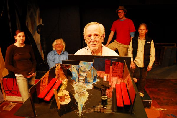 Director Bob Pond holds a model of the set for the play