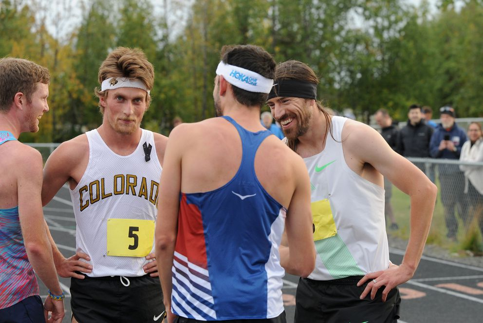 From left: Trevor Dunbar, Nick Harris, Kyle Merber and Ben Blankenship talk after the first race of the Great Alaska Mile Series race at West High on Wednesday. Kyle Merber won in 3:59:36. (Bob Hallinen / Alaska Dispatch News)