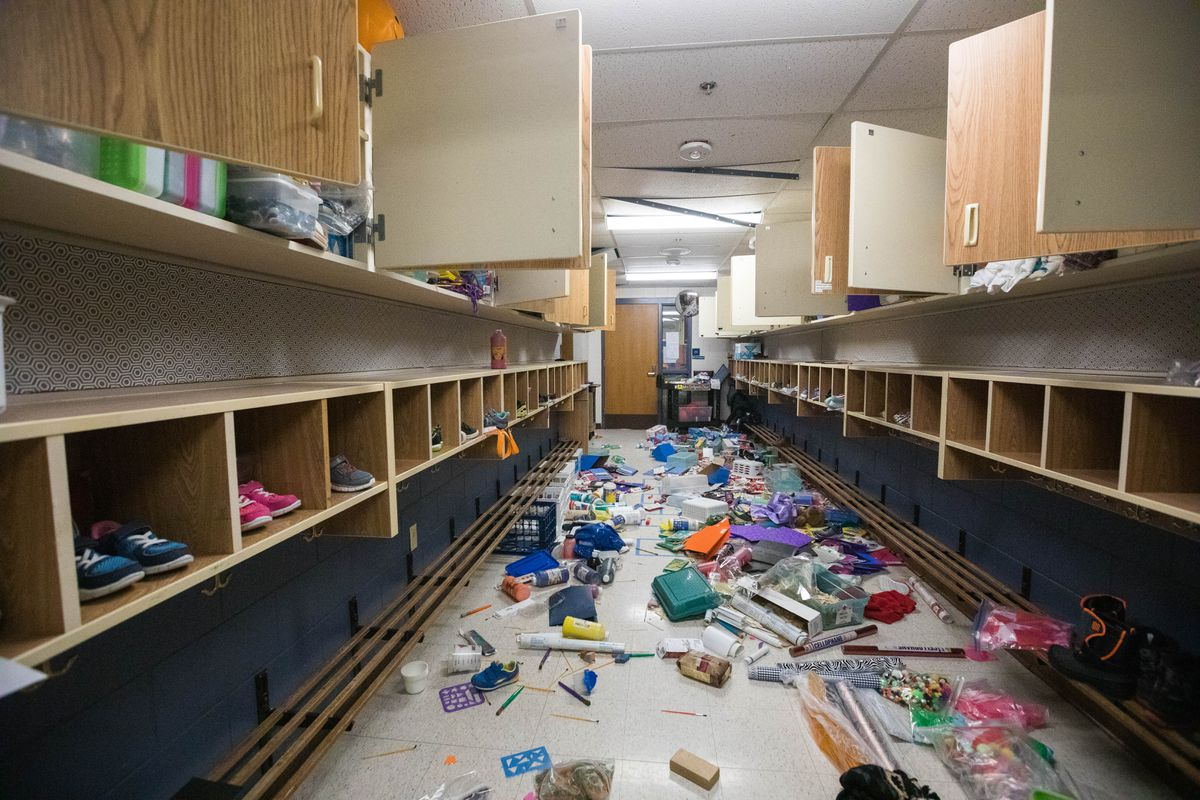 School supplies are strewn in a hallway at Eagle River Elementary School on Tuesday, Dec. 4, 2018. School was about to begin on Friday when a 7.0 earthquake struck, damaging the school so severely that officials decided to move students to different buildings for the rest of the year. (Loren Holmes / ADN)