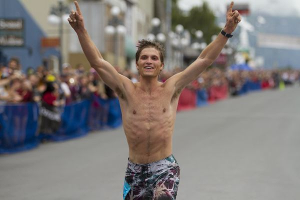 Mt. Marathon runner David Norris crosses the finish line beating the previous men's record time on July 4, 2016. Norris completed the race at 41:26. (Sarah Bell / Alaska Dispatch News)