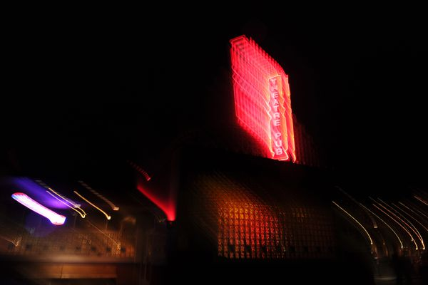 The neon sign at the Bear Tooth Theaterpub glows against the night sky in Anchorage, Alaska on Wednesday, Sept. 27, 2017. (Bob Hallinen / Alaska Dispatch News)