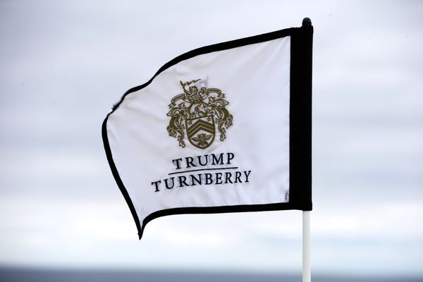 Trump Turnberry branding sits on a flag at the grand opening of The King Robert The Bruce Golf Course at Trump Turnberry golf resort. MUST CREDIT: Bloomberg photo by Matthew Lloyd