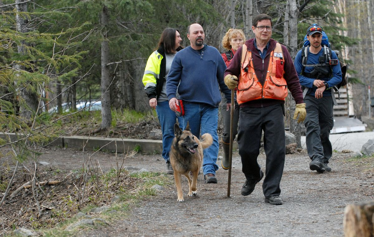 Searchers head out onto the trails at the Eagle River Nature Center while helping the search for missing hiker Neil Guggenmos on Wednesday, May 1, 2019. (Matt Tunseth / Chugiak-Eagle River Star)