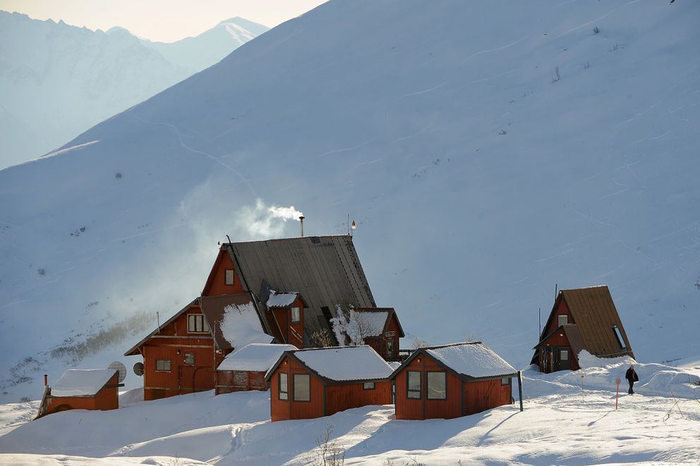Wood smoke streams out of the Hatcher Pass Lodge as it sits in bright sunshine February 3, 2015. (Erik Hill / ADN)