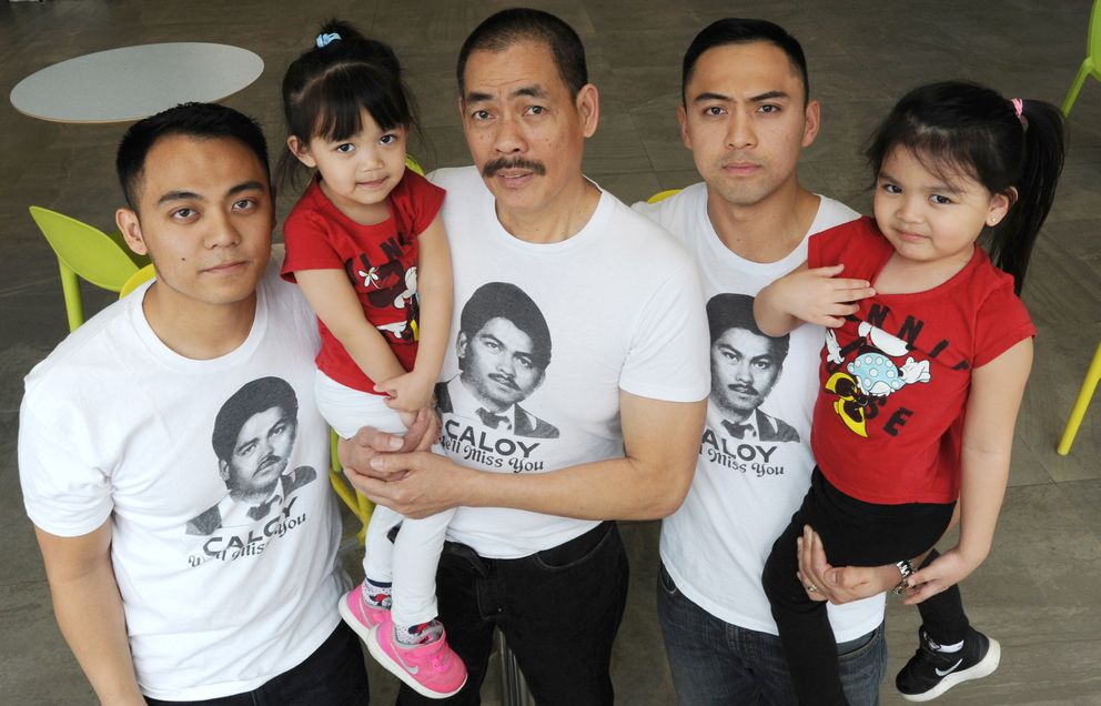Jerry Medina, center, who lives in Winnipeg, Manitoba, is back in Alaska on Sunday, April 22, 2018, seeking justice in the killing of his older brother, Carlos Medina. Pictured with him are Carlos' sons Carlo Medina, left, and Aloysius Medina, second from right, of Anchorage, and Carlos' granddaughters Snow Medina, 3, left, and Holly Medina, 4. (Bill Roth / ADN)