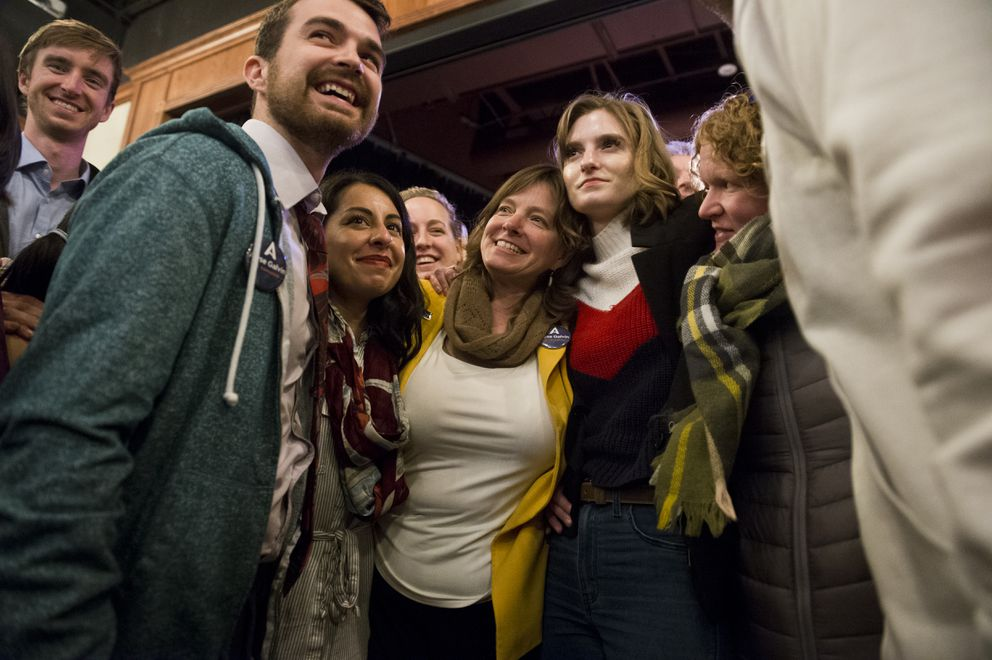 Congressional candidate Alyse Galvin gathers her campaign staff, volunteers and supporters together for a group hug to close out her Election Day gathering at 49th State Brewing Company on November 6, 2018. Galvin lost to Don Young. (Marc Lester / ADN)