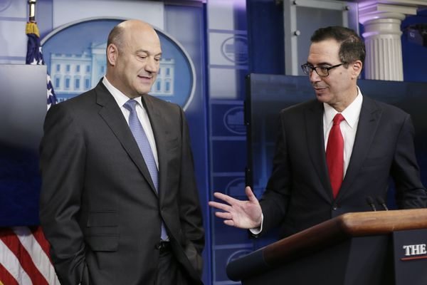 U.S. National Economic Director Gary Cohn (L) and Treasury Secretary Steven Mnuchin discuss the Trump administration's tax reform proposal in the White House briefing room in Washington, U.S, April 26, 2017. REUTERS/Kevin Lamarque