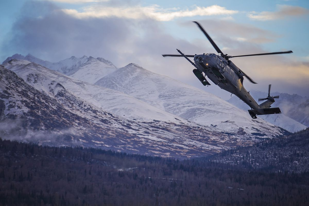 "An HH-60 Pave Hawk helicopter from the 210th Rescue Squadron, Alaska Air National Guard, practices ""touch and go"" maneuvers on Joint Base Elmendorf-Richardson, Dec. 17, 2014. (U.S. Army National Guard photo by Sgt. Edward Eagerton)"
