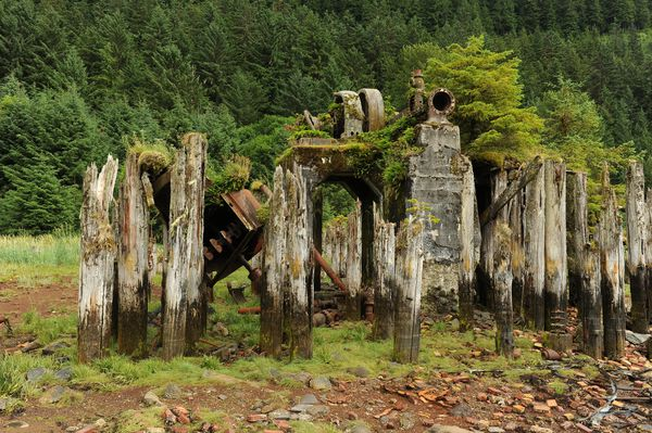 Old piles frame the cement structure holding a large electric generator at theold San Juan Fishing & Packing Co. cannery. (Bob Hallinen / ADN)