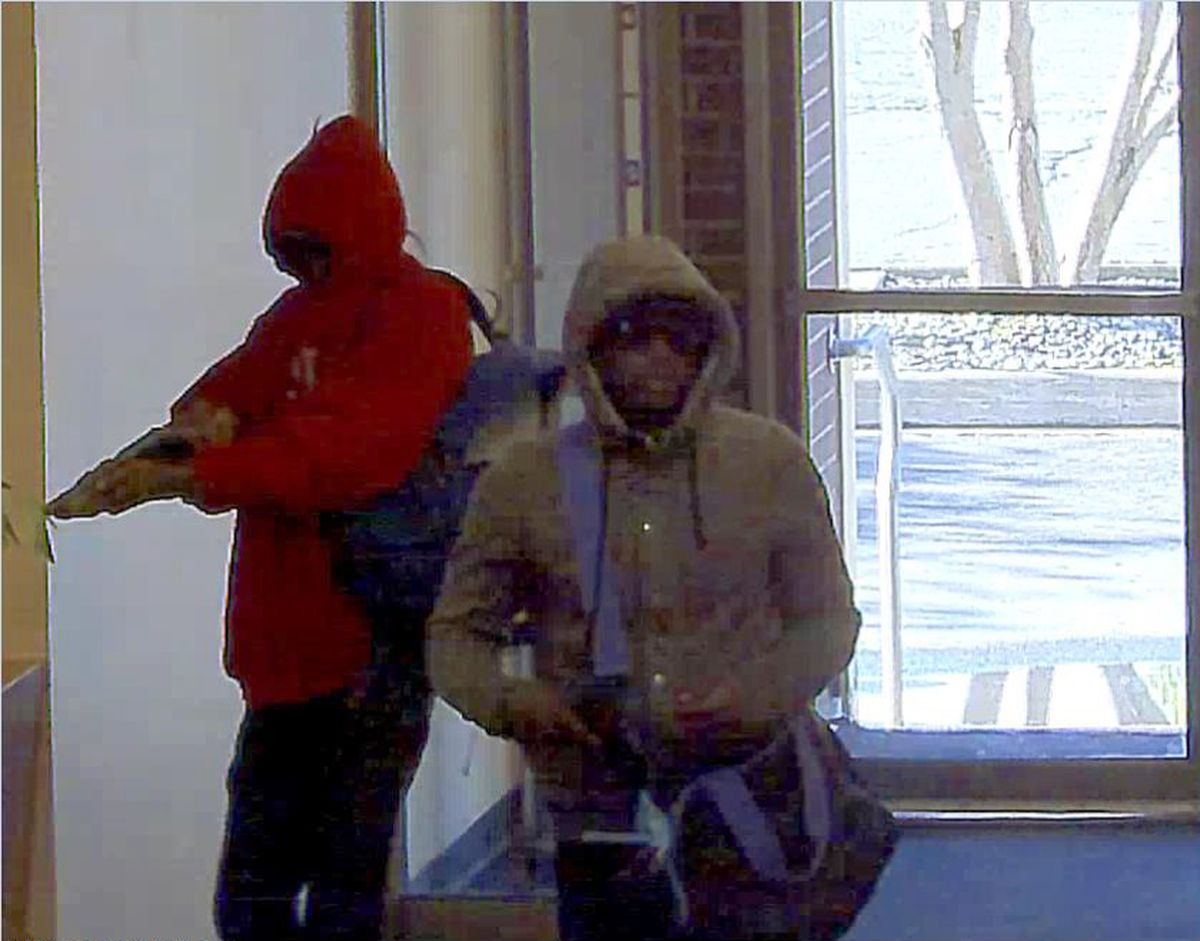 Surveillance images from the Wells Fargo bank on East Fifth Avenue show an armed robbery on Aug. 18, 2016. (Photo provided by FBI)