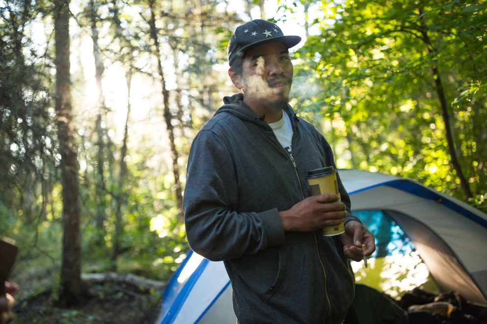 Randy Williams, who is homeless, smokes a cigarette at his camp in Valley of the Moon Park early Wednesday morning, Aug. 31, 2016. (Loren Holmes / Alaska Dispatch News)