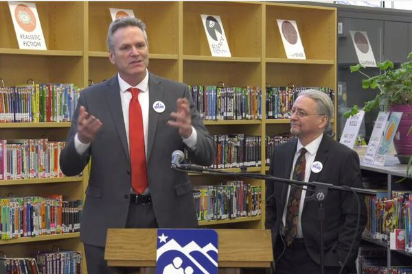 Gov. Mike Dunleavy, left, is seen at Turnagain Elementary School on Jan. 15, 2020 with Senate Minority Leader Tom Begich, D-Anchorage, as the pair announce agreement on bipartisan legislation intended to improve youth reading ability. (Office of the Governor video screenshot)
