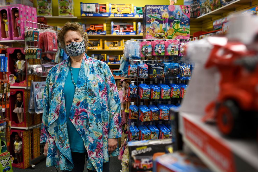 "Over the Rainbow toy store owner Janet Gregory said she has required masks in the store since they reopened a month ago. She's pleased to see the citywide requirement, she said. ""That takes the policing off of me and my staff, ' she said on June 29, 2020. (Marc Lester / ADN)"